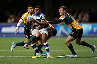 Semesa Rokoduguni of Bath Rugby looks for support as he is held by Calum Clark of Northampton Saints as George North of Northampton Saints supports during the Amlin Challenge Cup Final match between Bath Rugby and Northampton Saints at Cardiff Arms Park on Friday 23rd May 2014 (Photo by Rob Munro)