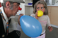 """Cris L'ariste an Israeli  medical clown who works in Hadassah and he is a member of a group call """"Dream Doctor"""", plays with a Maria (no second name given), a Palestinian girl, at the Oncology Day Care unit at Hadassah Ein Karem hospital. Photo by Quique Kierszenbaum."""