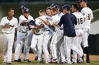 Fort Myers Miracle pinch hitter Aderlin Mejia (13) is mobbed by teammates including Engelb Vielma (7), Niko Goodrum (15), Chih-Wei Hu (30), Mitch Garver (25), Marcus Knecht (9), J.T. Chargois (16) and Aaron Slegers (31) after a walk off hit during a game against the St. Lucie Mets on April 19, 2015 at Hammond Stadium in Fort Myers, Florida.  Fort Myers defeated St. Lucie 3-2 in eleven innings.  (Mike Janes/Four Seam Images)