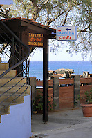 Taverna Gioma sign and staircase in Plakias village in Crete