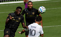 LOS ANGELES, CA - OCTOBER 25: Jesus David Murillo #94 of LAFC and Cristian Pavon #10 of the Los Angeles Galaxy battle during a game between Los Angeles Galaxy and Los Angeles FC at Banc of California Stadium on October 25, 2020 in Los Angeles, California.