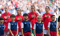 PARIS,  - JUNE 16: Becky Sauerbrunn #4, Mallory Pugh #2, Alyssa Naeher #1, and Carli Lloyd #10 stand for the national anthem during a game between Chile and USWNT at Parc des Princes on June 16, 2019 in Paris, France.