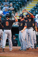 Fresno Grizzles second baseman Nolan Fontana (9) is congratulated by Tyler Heineman (8) and Jon Singleton (21) after hitting a home run during a game against the Oklahoma City Dodgers on June 1, 2015 at Chickasaw Bricktown Ballpark in Oklahoma City, Oklahoma.  Fresno defeated Oklahoma City 14-1.  (Mike Janes/Four Seam Images)