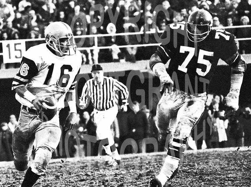 Chuck Ealey Hamilton Tiger Cats quarterback.is chased by Wayne Smith of the Ottawa Rough Riders. Copyright photograph Scott Grant/