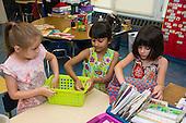 MR / Schenectady, NY. Zoller Elementary School (urban public school). Kindergarten classroom. Students (5: 6, bi-racial: 5) work together to clean up classroom. MR: Stu1, Myk1, Coh2. ID: AM-gKw. © Ellen B. Senisi.