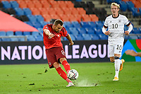 6th August 2020, Basel, Switzerland. UEFA National League football, Switzerland versus Germany;  Haris Seferovic, SUI takes a shot on goal watched by Julian Brandt, GER