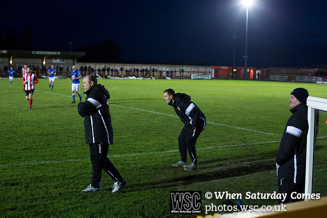 Witton Albion 1 Warrington Town 2, 26/12/2017. Wincham Park, Northern Premier League. Visiting coaching staff watching the action during the second half action at Wincham Park, home of Witton Albion (in red) during their Northern Premier League premier division fixture with Warrington Town. Formed in 1887, the home team have played at their current ground since 1989 having relocated from the Central Ground in Northwich. With both team chasing play-off spots, the visitors emerged with a 2-1 victory, the winner being scored by Tony Gray in second half injury time, watched by a crowd of 503. Photo by Colin McPherson.