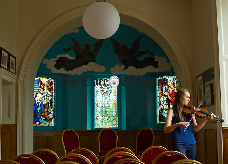 Musician Laura Donnell of the Cnoc na Gaoithe Session group, playing  in the Cnoc na Gaoithe Cultural Centre at Tulla. Photograph by John Kelly.