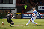 Jamie Hamill scores a rebound after keeper Scott Fox saved the penalty kick