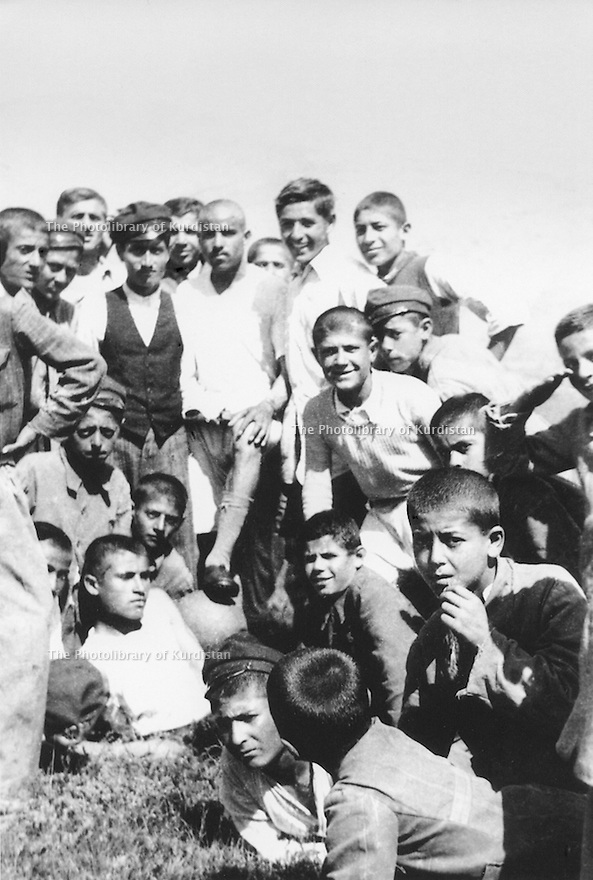Iran 1948?  .Schoolboys  having their picture taken  after a football training .Iran 1948? .Ecoliers apres un entrainement de football