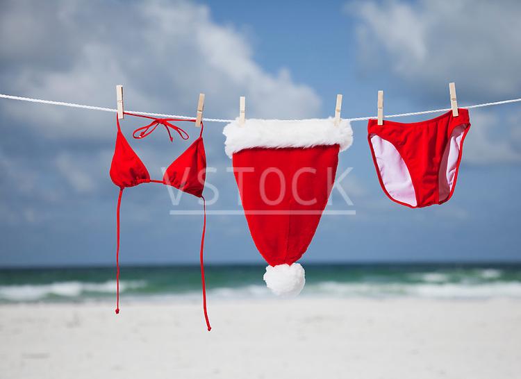 USA, Florida, St. Pete Beach, Santa hat and bikini hanging on clothesline on beach