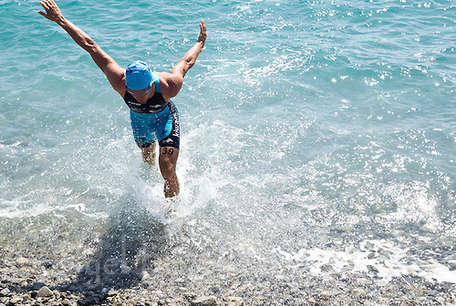 16 SEP 2012 - NICE, FRA - Akos Vanek of TCG 79 Parthenay leaves the water after a warm up swim before the start of the French Grand Prix triathlon series final stage held during the Triathlon de Nice Côte d'Azur (PHOTO (C) 2012 NIGEL FARROW)