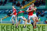 Ronan Buckley, East Kerry in action against Peter Crowley and Pa Wrenn, Mid Kerry during the Kerry County Senior Football Championship Final match between East Kerry and Mid Kerry at Austin Stack Park in Tralee on Saturday night.