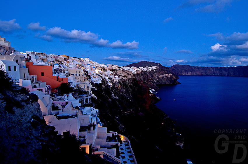 A  few minutes before night fall,  the Volcanic cliffs and the white buildings of the village on Santorini, Greece