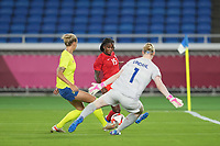 YOKOHAMA, JAPAN - AUGUST 6: Hedvig Lindahl #1 of Sweden dfeds Nichelle Prince #15 of Canada during a game between Canada and Sweden at International Stadium Yokohama on August 6, 2021 in Yokohama, Japan.