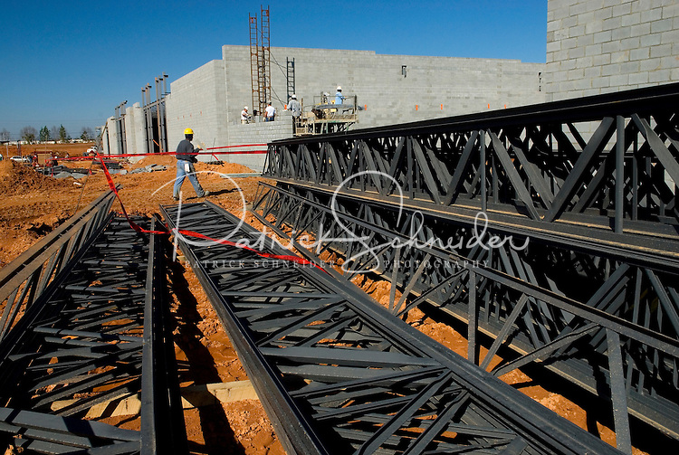 02/22/07:  Steel support beams lay ready to be placed during expansion/construction of a Charlotte-area shopping center. Charlotte, NC, is one of the country's fastest-growing cities. ..By Patrick Schneider- Patrick Schneider Photography.