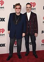 2021 IHEART RADIO MUSIC AWARDS:  Elton John and David Furnish attend the 2021 IHEARTRADIO MUSIC AWARDS airing live May 27 (8:00-10:00 PM ET / PT tape-delayed) on FOX . (Photo by Scott Kirkland/FOX/PictureGroup). © 2021 FOX MEDIA , LLC.