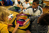 MR / Schenectady, New York. Yates Arts in Education Magnet School (urban public school). Grade 3. Students work cooperatively on a painting using a circles theme during art class. (Foreground: girls: 8,9; Boy: 8, AfricanAmerican.) ID: L-C. MR: Rod5 Ser1 ©Ellen B. Senisi