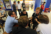 Wednesday 28 August 2013<br /> Pictured: Gerhard Tremmel (Top R) interviewed  by members of the press at Cardiff Airport.<br /> Re: Swansea City FC players and staff en route for their UEFA Europa League, play off round, 2nd leg, against Petrolul Ploiesti in Romania.