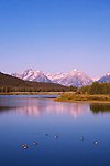 Early morning light creates reflectons of the Grand Teton Mountains in Wyoming's Snake River.  Grand Teton National Park, United States, Wyoming.