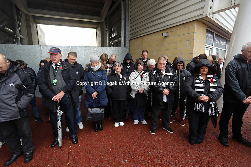 Pictured: Swansea supporters observe a minute's silence after the plaque unveiling Sunday 09 November 2014<br /> Re: Swansea City FC have unveiled a plaque for three former players who died during the First World War commemorating this way Remembrance Sunday. It was unveiled before the Barclays Premier League, Swansea City FC v Arsenal City at the Liberty Stadium, south Wales, UK