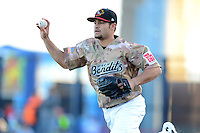 Quad Cities River Bandits starting pitcher Lance McCullers #23 runs the runner back to third in a rundown during a game against the Wisconsin Timber Rattlers on May 24, 2013 at Modern Woodmen Park in Davenport, Iowa.  Quad Cities defeated Wisconsin 4-3  (Mike Janes/Four Seam Images)