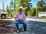Dad having a snack at the trail head. Sierra National Forest, on the western slope of the Sierra Nevada, California
