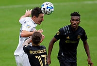 LOS ANGELES, CA - OCTOBER 25: Sacha Kljestan #16 of the Los Angeles Galaxy heads a ball away during a game between Los Angeles Galaxy and Los Angeles FC at Banc of California Stadium on October 25, 2020 in Los Angeles, California.