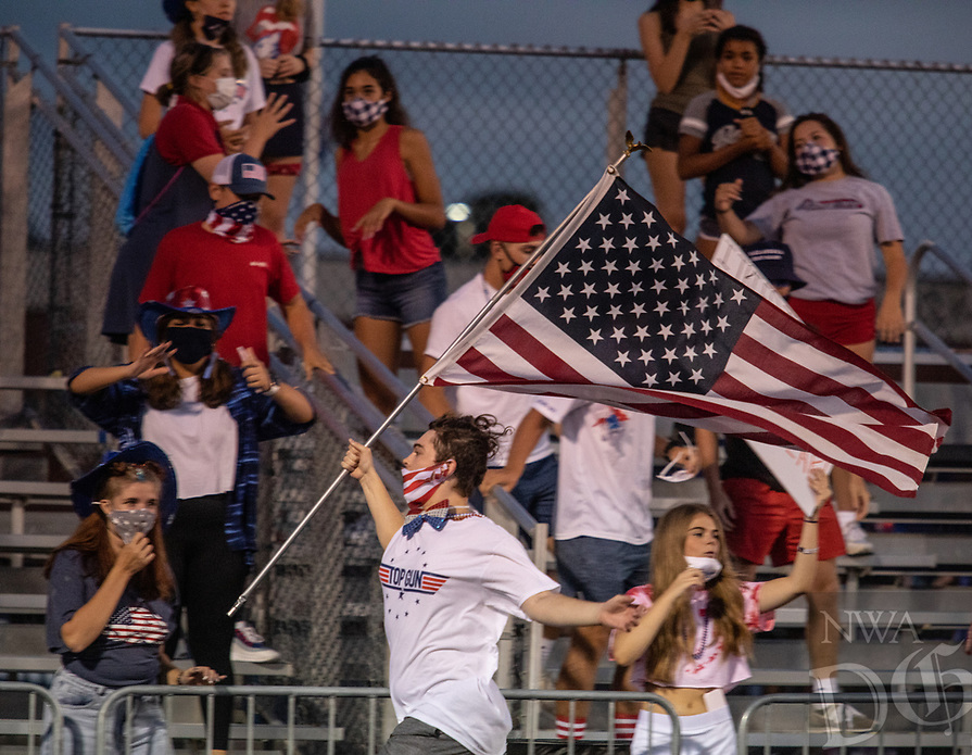 The Greenwood High School student section celebrates a touchdown during Friday's football game against Springdale Har-Ber. Many students dressed in patriotic colors since the game was played on 9/11.