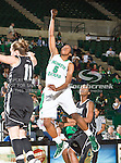 North Texas Mean Green guard Brittney Hudson (5) in action during the game between the Troy Trojans and the University of North Texas Mean Green at the North Texas Coliseum,the Super Pit, in Denton, Texas. UNT defeats Troy 57 to 36.....