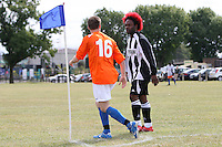 An FC Metwin player speaks to an Adam & Eve FC player during a Hackney & Leyton Sunday League game at Hackney Marshes - 06/09/09 - MANDATORY CREDIT: Gavin Ellis/TGSPHOTO - Self billing applies where appropriate - Tel: 0845 094 6026