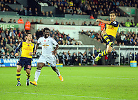 Sunday 09 November 2014 <br /> Pictured L-R: Nacho Monreal of Arsenal and Wilfried Bony of Swansea and Mathieu Flamini of Arsenal<br /> Re: Barclays Premier League, Swansea City FC v Arsenal City at the Liberty Stadium, Swansea, Great Britain.
