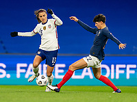 LE HAVRE, FRANCE - APRIL 13: Alex Morgan #13 of the USWNT fights for the ball with Elisa De Almeida #22 of France during a game between France and USWNT at Stade Oceane on April 13, 2021 in Le Havre, France.