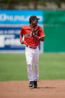 Batavia Muckdogs center fielder Brayan Hernandez (18) jogs to the dugout during a game against the Lowell Spinners on July 15, 2018 at Dwyer Stadium in Batavia, New York.  Lowell defeated Batavia 6-2.  (Mike Janes/Four Seam Images)