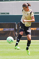 Christine Sinclair #12 of FC Gold Pride stops a loose ball against the Los Angeles Sol during their match at Home Depot Center on April 19, 2009 in Carson, California.