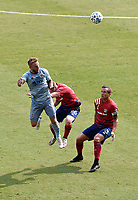 KANSAS CITY, KS - SEPTEMBER 19: Johnny Russell #7 of Sporting Kansas City heads the ball in midfield as John Nelson #26 and Reto Ziegler #3 of FC Dallas try to stop him during a game between FC Dallas and Sporting Kansas City at Children's Mercy Park on September 19, 2020 in Kansas City, Kansas.