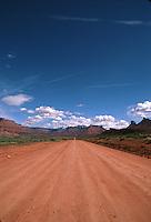 A deserted red dirt road. Utah.