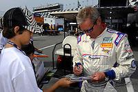 28-31 January, 2010, Daytona Beach, Florida  USA.Hurley Haywood signs an autograph..©F. Peirce Williams 2010 USA.