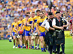 The Clare team marches behind the band before the All-Ireland semi-final replay against Galway at Semple Stadium,Thurles. Photograph by John Kelly.