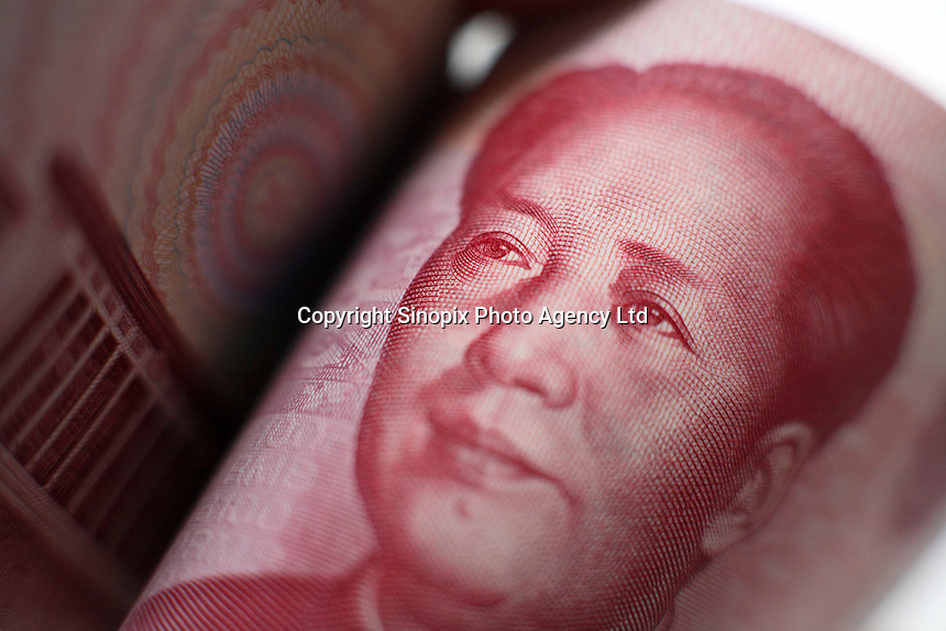 Close up of an one hundred Chinese Yuan (RMB) note displayed for photographs in Shanghai, China..