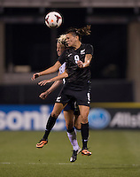 Megan Rapinoe (15) of the USWNT goes up for a header with Amber Hearn (9) of New Zealandl during an international friendly at Crew Stadium in Columbus, OH. The USWNT tiedNew Zealand, 1-1.