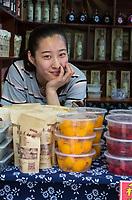 Suzhou, Jiangsu, China.  Young Woman Posing for Photo in Tongli Ancient Town near Suzhou.