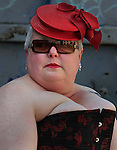 A woman dressed up in a fancy hat for the Folsom Street Fair, in San Francisco.