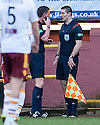 Craig Thomson consults his stand side assistant before chalking off Motherwell's John Sutton's goal.
