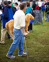 A man using a crutch holds a soft toy at the Inveraray Highland Games, held at Inveraray Castle in Argyll.