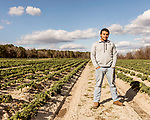 December 30, 2016. Rose Hill, North Carolina.<br /> <br /> John Dunn stands in a field owned by Cottles Organics, a farm where he has worked since he was a child. <br />  <br /> John Dunn, age 19, is currently a freshman at NC State University and is the first person in his family to go to college. With a combination of grants, loans, help from his grandfather and weekend farm work, Dunn hopes to find finish college and find a career in agriculture.<br /> <br />  Colleges and universities, which are always trying to pinpoint an under-served and sometimes underprivileged populations of students, have noted a decline in students from rural areas of the country. There are various efforts underway in colleges and universities to identify more of these kids and get them enrolled.