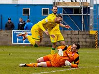 18th April 2021; Stair Park, Stranraer, Dumfries, Scotland; Scottish Cup Football, Stranraer versus Hibernian; Greg Fleming of Stranraer slides in and fouls Martin Boyle of Hibernian