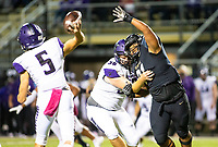 Tyson Wimbley (91) of  Bentonville applies pressure to Jackson Leichner (5) (QB) Chayse Williams (56) of Fayetteville (Blocker) of Fayetteville  to at Tigers Stadium, Bentonville, Arkansas on Friday, October 16, 2020 / Special to NWA Democrat-Gazette/ David Beach