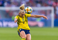 LE HAVRE,  - JUNE 20: Stina Blackstenius #11 heads the ball during a game between Sweden and USWNT at Stade Oceane on June 20, 2019 in Le Havre, France.