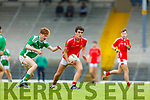 Paudie O'Leary East Kerry sets up another attack under pressure from Ethan O'Neill during their County Minor Championship semi final in Fitzgerald stadium on Monday evening